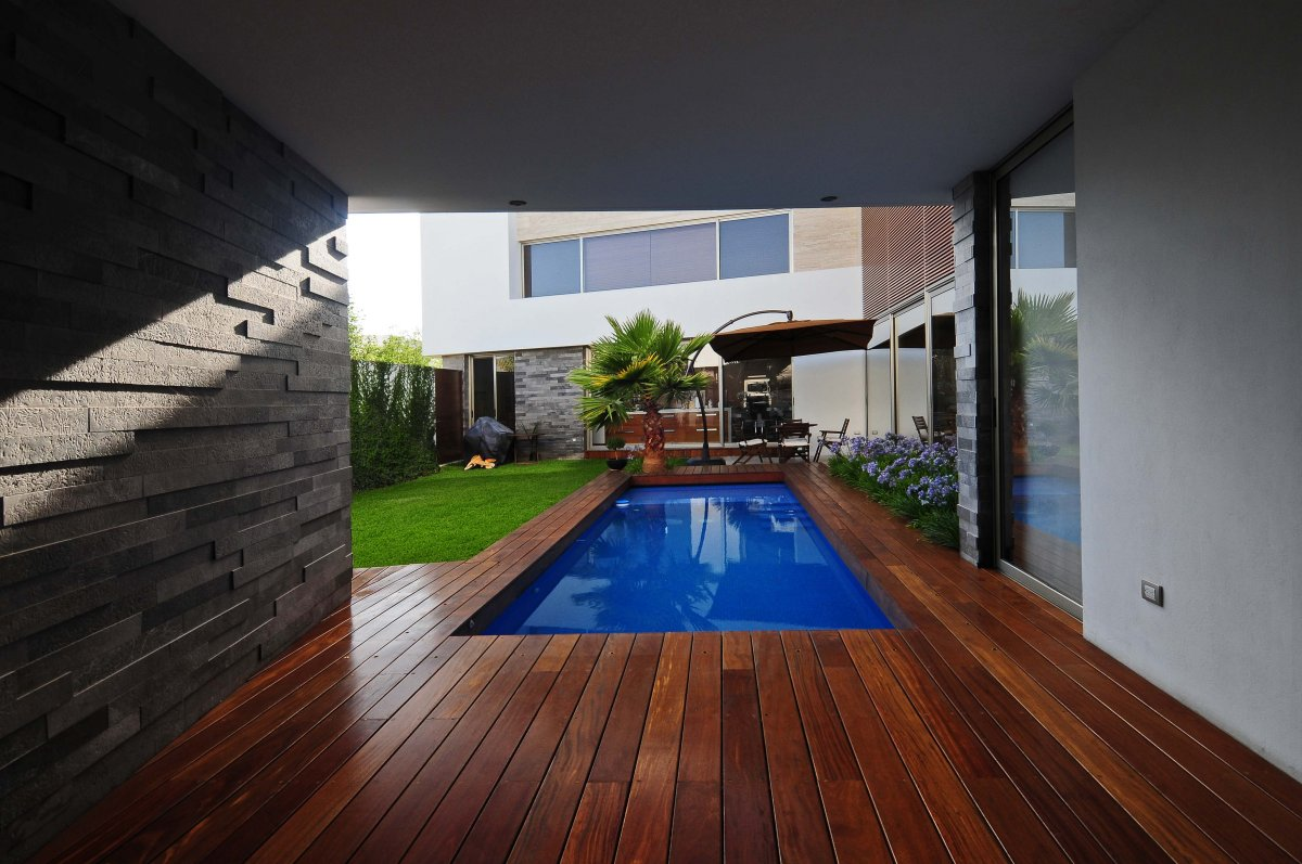 Blue-Swimming-Pool-In-Wooden-Parquet-Floor
